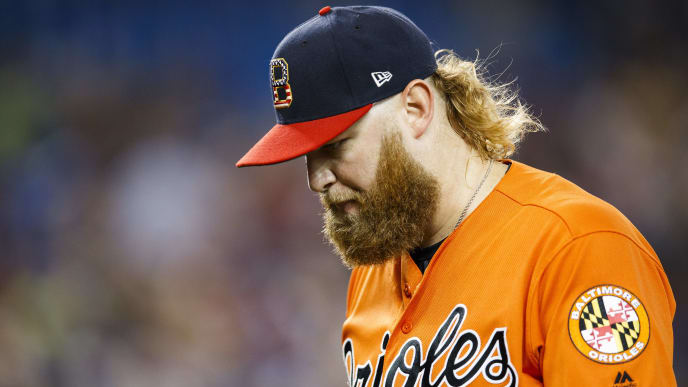 TORONTO, ONTARIO - JULY 6: Andrew Cashner #54 of the Baltimore Orioles comes off the mound against Toronto Blue Jays at the end of the sixth inning during their MLB game at the Rogers Centre on July 6, 2019 in Toronto, Canada. (Photo by Mark Blinch/Getty Images)