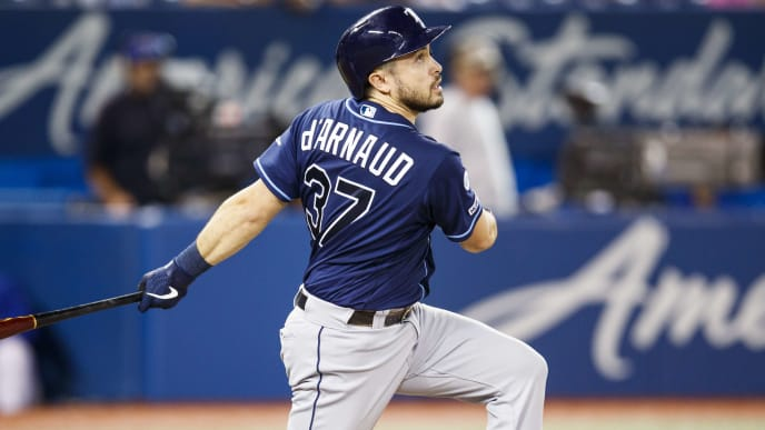 TORONTO, ONTARIO - SEPTEMBER 27: Travis d'Arnaud #37 of the Tampa Bay Rays hits a single against the Toronto Blue Jays in the eighth inning during their MLB game at the Rogers Centre on September 27, 2019 in Toronto, Canada. (Photo by Mark Blinch/Getty Images)