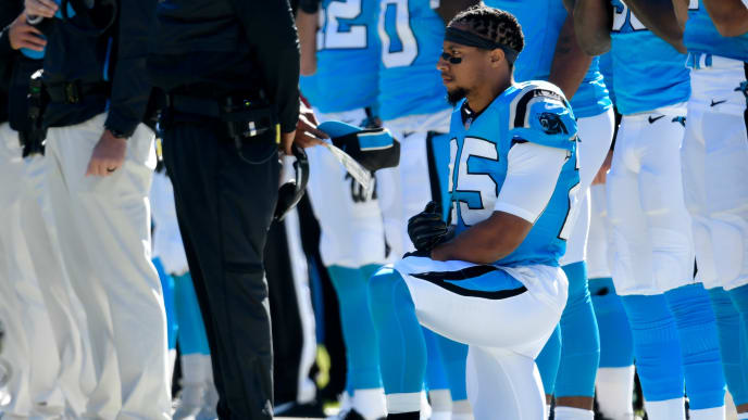 CHARLOTTE, NC - OCTOBER 28:  Eric Reid #25 of the Carolina Panthers kneels during the anthem against the Baltimore Ravens at Bank of America Stadium on October 28, 2018 in Charlotte, North Carolina.  (Photo by Grant Halverson/Getty Images)