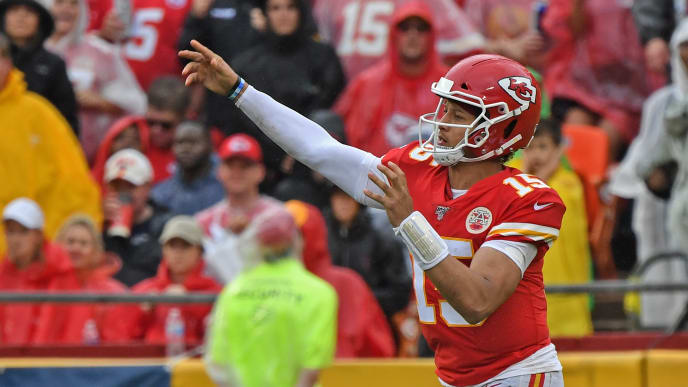 KANSAS CITY, MO - SEPTEMBER 22:  Quarterback Patrick Mahomes #15 of the Kansas City Chiefs throws a pass against Baltimore Ravens during the second half at Arrowhead Stadium on September 22, 2019 in Kansas City, Missouri. (Photo by Peter Aiken/Getty Images)