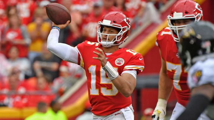KANSAS CITY, MO - SEPTEMBER 22:  Quarterback Patrick Mahomes #15 of the Kansas City Chiefs passes against the Baltimore Ravens during the second half at Arrowhead Stadium on September 22, 2019 in Kansas City, Missouri. (Photo by Peter Aiken/Getty Images)