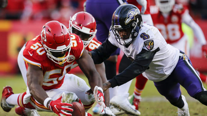 KANSAS CITY, MO - DECEMBER 09: Outside linebacker Justin Houston #50 of the Kansas City Chiefs strips the football from quarterback Lamar Jackson #8 of the Baltimore Ravens late in the fourth quarter at Arrowhead Stadium on December 9, 2018 in Kansas City, Missouri. The Chiefs won in overtime, 27-24. (Photo by David Eulitt/Getty Images)