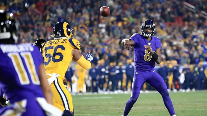 LOS ANGELES, CALIFORNIA - NOVEMBER 25:  Quarterback Lamar Jackson #8 of the Baltimore Ravens delivers a pass against the Los Angeles Rams at Los Angeles Memorial Coliseum on November 25, 2019 in Los Angeles, California. (Photo by Sean M. Haffey/Getty Images)