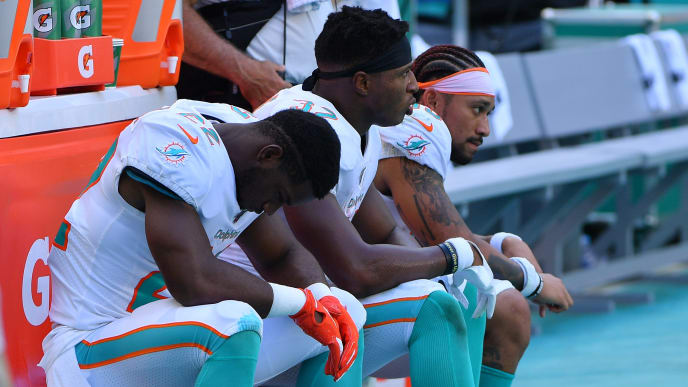 MIAMI, FLORIDA - SEPTEMBER 08: Mark Walton #22, Kenyan Drake #32 and Albert Wilson #15 of the Miami Dolphins look on in the fourth quarter against the Baltimore Ravens at Hard Rock Stadium on September 08, 2019 in Miami, Florida. (Photo by Mark Brown/Getty Images)
