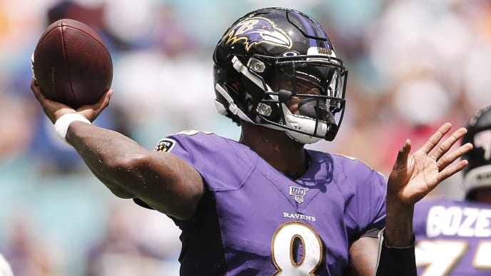 MIAMI, FLORIDA - SEPTEMBER 08: Lamar Jackson #8 of the Baltimore Ravens throws a pass against the Miami Dolphins during the first quarter at Hard Rock Stadium on September 08, 2019 in Miami, Florida. (Photo by Michael Reaves/Getty Images)