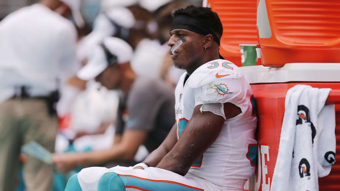 MIAMI, FLORIDA - SEPTEMBER 08:  Kenyan Drake #32 of the Miami Dolphins reacts against the Baltimore Ravens during the second quarter at Hard Rock Stadium on September 08, 2019 in Miami, Florida. (Photo by Michael Reaves/Getty Images)