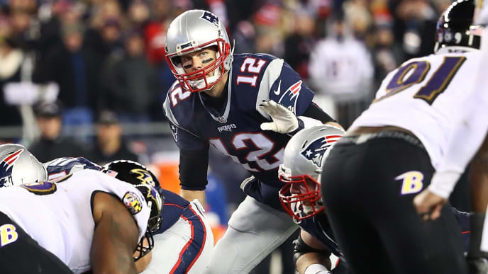 FOXBORO, MA - DECEMBER 12:  Tom Brady #12 of the New England Patriots communicates during the first half against the Baltimore Ravens at Gillette Stadium on December 12, 2016 in Foxboro, Massachusetts.  (Photo by Adam Glanzman/Getty Images)