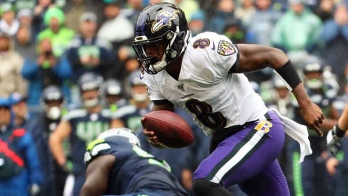 SEATTLE, WASHINGTON - OCTOBER 20: Lamar Jackson #8 of the Baltimore Ravens runs with the ball in the first quarter against the Seattle Seahawks during their game at CenturyLink Field on October 20, 2019 in Seattle, Washington. (Photo by Abbie Parr/Getty Images)