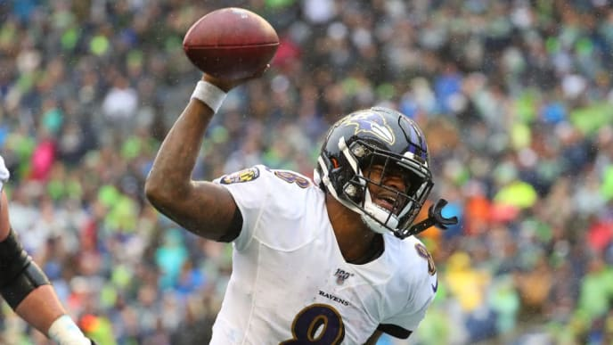 SEATTLE, WASHINGTON - OCTOBER 20: Lamar Jackson #8 of the Baltimore Ravens celebrates after scoring an eight yard touchdown against the Seattle Seahawks in the third quarter during their game at CenturyLink Field on October 20, 2019 in Seattle, Washington. (Photo by Abbie Parr/Getty Images)