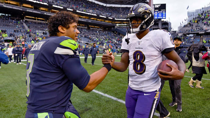 SEATTLE, WASHINGTON - OCTOBER 20: Russell Wilson #3 of the Seattle Seahawks and Lamar Jackson #8 of the Baltimore Ravens shake hands after the game at CenturyLink Field on October 20, 2019 in Seattle, Washington. The Baltimore Ravens top the Seattle Seahawks 30-16. (Photo by Alika Jenner/Getty Images)