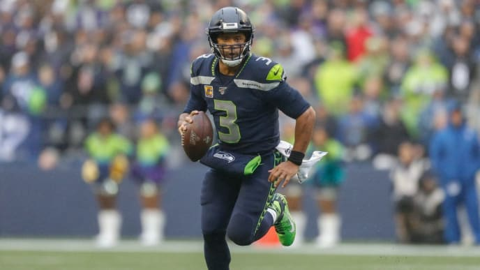 SEATTLE, WA - OCTOBER 20:  Quarterback Russell Wilson #3 of the Seattle Seahawks rolls out to pass against the Baltimore Ravens at CenturyLink Field on October 20, 2019 in Seattle, Washington.  (Photo by Otto Greule Jr/Getty Images)