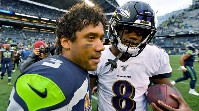 SEATTLE, WASHINGTON - OCTOBER 20: Russell Wilson #3 of the Seattle Seahawks and Lamar Jackson #8 of the Baltimore Ravens hug after the game at CenturyLink Field on October 20, 2019 in Seattle, Washington. The Baltimore Ravens top the Seattle Seahawks 30-16. (Photo by Alika Jenner/Getty Images)