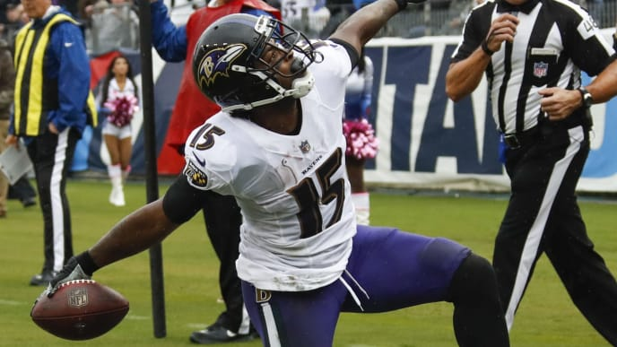 NASHVILLE, TN - OCTOBER 14: Michael Crabtree #15 of the Baltimore Ravens celebrates scoring a touchdown in the first quarter against the Tennessee Titans at Nissan Stadium on October 14, 2018 in Nashville, Tennessee. (Photo by Frederick Breedon/Getty Images)