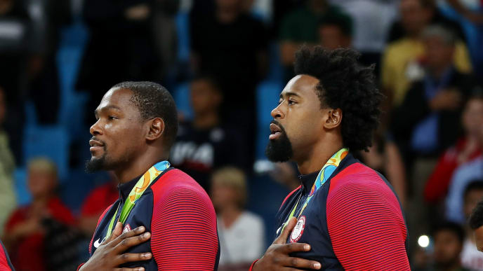 RIO DE JANEIRO, BRAZIL - AUGUST 21:  Jimmy Butler, Kevin Durant, DeAndre Jordan and Kyle Lowry, of United States stand on the podium for the National Anthem after defeating Serbia in the Men's Gold medal game on Day 16 of the Rio 2016 Olympic Games at Carioca Arena 1 on August 21, 2016 in Rio de Janeiro, Brazil.  (Photo by Elsa/Getty Images)