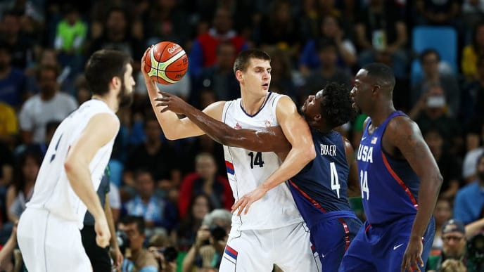 RIO DE JANEIRO, BRAZIL - AUGUST 21:  Nikola Jokic #14 of Serbia looks to pass the ball over Jimmy Butler #4 of United States during the Men's Gold medal game on Day 16 of the Rio 2016 Olympic Games at Carioca Arena 1 on August 21, 2016 in Rio de Janeiro, Brazil.  (Photo by Elsa/Getty Images)