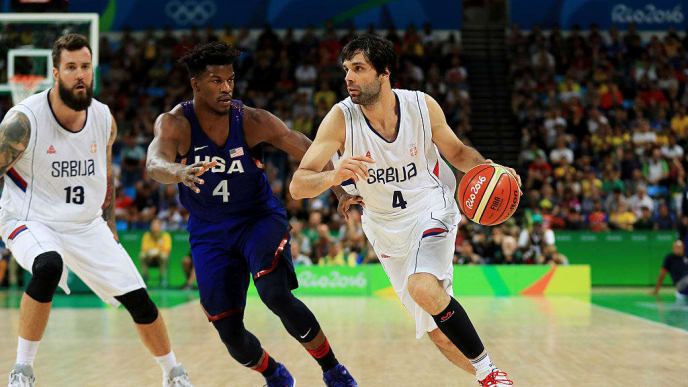 RIO DE JANEIRO, BRAZIL - AUGUST 21:  Milos Teodosic #4 of Serbia drives the ball around Jimmy Butler #4 of United States during the Men's Gold medal game on Day 16 of the Rio 2016 Olympic Games at Carioca Arena 1 on August 21, 2016 in Rio de Janeiro, Brazil.  (Photo by Mike Ehrmann/Getty Images)