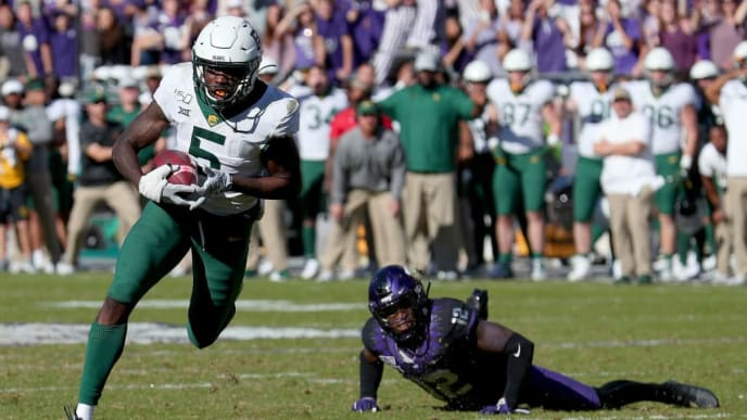 FORT WORTH, TEXAS - NOVEMBER 09: Denzel Mims #5 of the Baylor Bears scores a touchdown against Jeff Gladney #12 of the TCU Horned Frogs in the second overtime period at Amon G. Carter Stadium on November 09, 2019 in Fort Worth, Texas. (Photo by Tom Pennington/Getty Images)