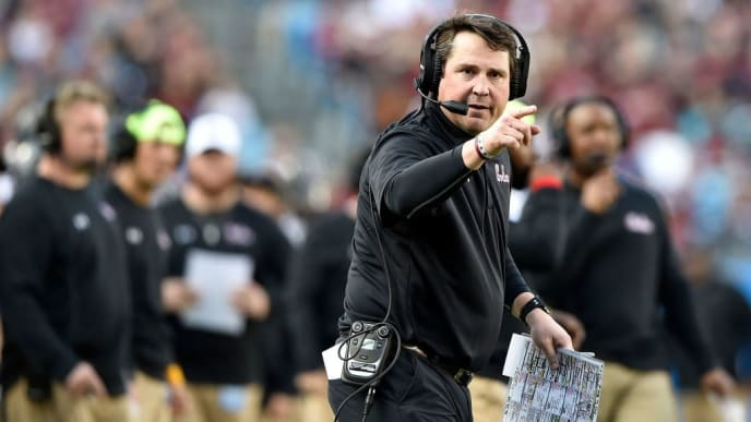 CHARLOTTE, NORTH CAROLINA - DECEMBER 29: Head coach Will Muschamp of the South Carolina Gamecocks  directs his team against the Virginia Cavaliers during the Belk Bowl at Bank of America Stadium on December 29, 2018 in Charlotte, North Carolina. Virginia won 28-0. (Photo by Grant Halverson/Getty Images)