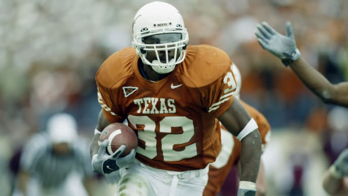 AUSTIN, TX - NOVEMBER 29:  Running back Cedric Benson #32 of the University of Texas at Austin Longhorns scores a touchdown during a game against the Texas A&M University Aggies at Memorial Stadium on November 29, 2002 in Austin, Texas.  The Longhorns defeated the Aggies 50-20.  (Photo by Ronald Martinez/Getty Images)