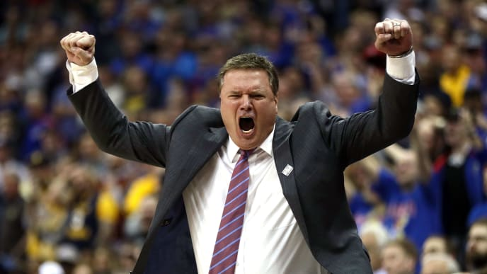 KANSAS CITY, MO - MARCH 10:  Head coach Bill Self of the Kansas Jayhawks celebrates as the Jayhawks defeat the West Virginia Mountaineers 81-70 to win the Big 12 Basketball Tournament Championship game at Sprint Center on March 10, 2018 in Kansas City, Missouri.  (Photo by Jamie Squire/Getty Images)