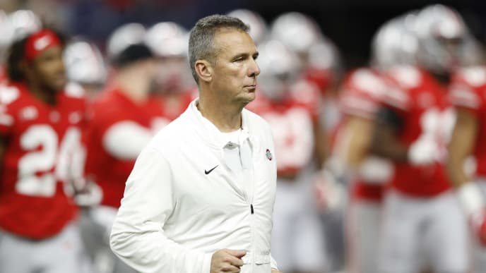 INDIANAPOLIS, INDIANA - DECEMBER 01: Head coach Urban Meyer of the Ohio State Buckeyes runs off the field at halftime in the game against the Northwestern Wildcats at Lucas Oil Stadium on December 01, 2018 in Indianapolis, Indiana. (Photo by Joe Robbins/Getty Images)