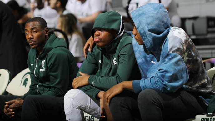 EAST LANSING, MI - NOVEMBER 10: Cassius Winston #5 of the Michigan State Spartans and his brother Khy Winston watch warm ups prior to the game against the Binghamton Bearcats at Breslin Center on November 10, 2019 in East Lansing, Michigan. (Photo by Rey Del Rio/Getty Images)
