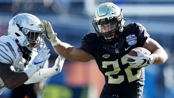 BIRMINGHAM, AL - DECEMBER 22: Matt Colburn #22 of the Wake Forest Demon Deacons runs the ball against the Memphis Tigers in the third quarter of the Birmingham Bowl at Legion Field on December 22, 2018 in Birmingham, Alabama. Wake Forest won 37-34. (Photo by Joe Robbins/Getty Images)