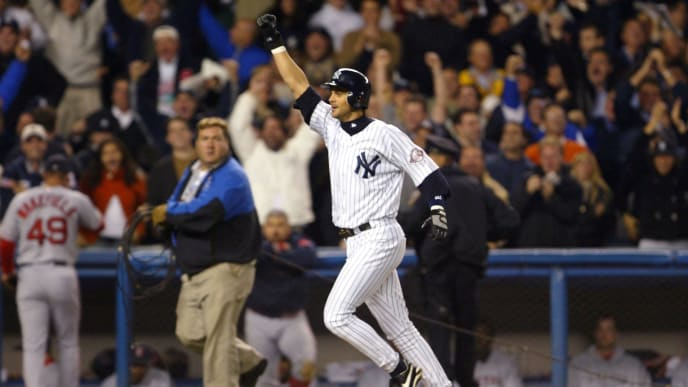 BRONX, NY - OCTOBER 16:  Aaron Boone #19 of the New York Yankees celebrates after hitting the game winning home run in the bottom of the eleventh inning against the Boston Red Sox during game 7 of the American League Championship Series on October 16, 2003 at Yankee Stadium in the Bronx, New York. The Yankees won 6-5, advancing them to the World Series.  (Photo by Ezra Shaw/Getty Images)