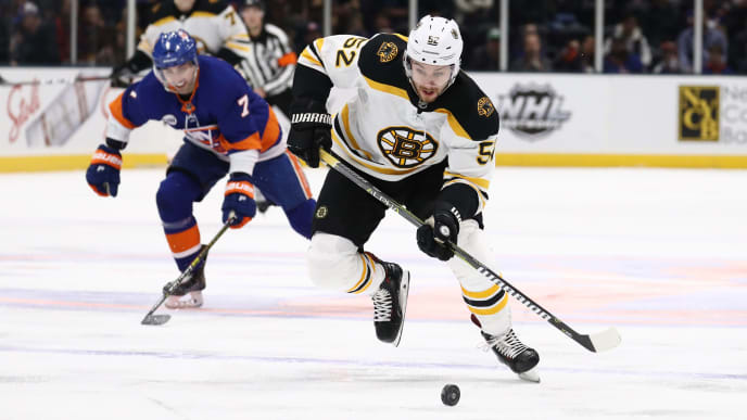 UNIONDALE, NEW YORK - MARCH 19:  Sean Kuraly #52 of the Boston Bruins in action against the New York Islanders during their game at NYCB Live's Nassau Coliseum on March 19, 2019 in Uniondale, New York. (Photo by Al Bello/Getty Images)