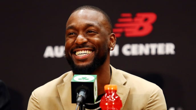 BOSTON, MASSACHUSETTS - JULY 17: Kemba Walker reacts during a press conference as he is introduced as a member of the Boston Celtics at the Auerbach Center at New Balance World Headquarters on July 17, 2019 in Boston, Massachusetts. (Photo by Tim Bradbury/Getty Images)