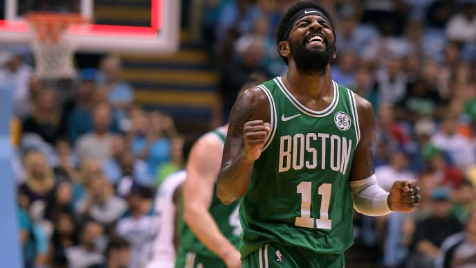 CHAPEL HILL, NC - SEPTEMBER 28: Kyrie Irving #11 of the Boston Celtics reacts after missing a three-point shot as time expired in the first quarter during their game against the Charlotte Hornets during the preseason game at Dean Smith Center on September 28, 2018 in Chapel Hill, North Carolina. NOTE TO USER: User expressly acknowledges and agrees that, by downloading and or using this photograph, User is consenting to the terms and conditions of the Getty Images License Agreement. (Photo by Lance King/Getty Images)