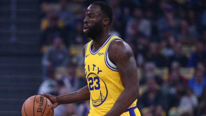 SAN FRANCISCO, CALIFORNIA - NOVEMBER 15: Draymond Green #23 of the Golden State Warriors dibbles the ball against the Boston Celtics during the first half of an NBA basketball game at Chase Center on November 15, 2019 in San Francisco, California. NOTE TO USER: User expressly acknowledges and agrees that, by downloading and or using this photograph, User is consenting to the terms and conditions of the Getty Images License Agreement. (Photo by Thearon W. Henderson/Getty Images)