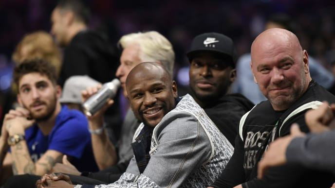 LOS ANGELES, CA - NOVEMBER 20: Boxer Floyd Mayweather Jr.and UFC President Dana White seated together during the Los Angeles Clippers and the Boston Celtics basketball game at Staples Center on November 20, 2019 in Los Angeles, California. NOTE TO USER: User expressly acknowledges and agrees that, by downloading and/or using this Photograph, user is consenting to the terms and conditions of the Getty Images License Agreement. (Photo by Kevork Djansezian/Getty Images)