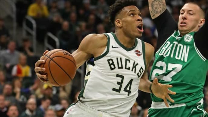 MILWAUKEE, WISCONSIN - MAY 08: Giannis Antetokounmpo #34 of the Milwaukee Bucks drives against Daniel Theis #27 of the Boston Celtics at Fiserv Forum on May 08, 2019 in Milwaukee, Wisconsin. The Bucks defeated the Celtics 116-91. NOTE TO USER: User expressly acknowledges and agrees that, by downloading and or using this photograph, User is consenting to the terms and conditions of the Getty Images License Agreement. (Photo by Jonathan Daniel/Getty Images)