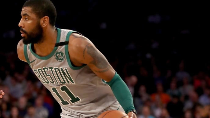 NEW YORK, NY - FEBRUARY 24:  Kyrie Irving #11 of the Boston Celtics heads for the net in the second hafl against the New York Knicks at Madison Square Garden on February 24,2018 in New York City. NOTE TO USER: User expressly acknowledges and agrees that, by downloading and or using this Photograph, user is consenting to the terms and conditions of the Getty Images License Agreement  (Photo by Elsa/Getty Images)