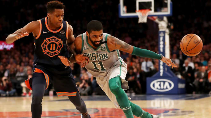 NEW YORK, NY - FEBRUARY 24:  Kyrie Irving #11 of the Boston Celtics tries to get past Frank Ntilikina #11 of the New York Knicks at Madison Square Garden on February 24,2018 in New York City. NOTE TO USER: User expressly acknowledges and agrees that, by downloading and or using this Photograph, user is consenting to the terms and conditions of the Getty Images License Agreement  (Photo by Elsa/Getty Images)
