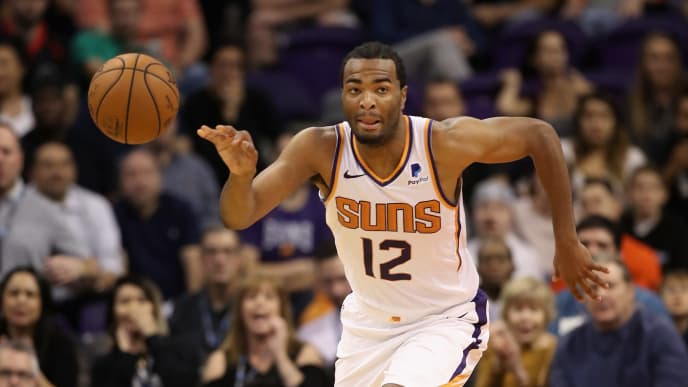 PHOENIX, AZ - NOVEMBER 08:  TJ Warren #12 of the Phoenix Suns handles the ball during the NBA game against the Boston Celtics at Talking Stick Resort Arena on November 8, 2018 in Phoenix, Arizona. The Celtics defeated the Suns 116-109 in overtime.  NOTE TO USER: User expressly acknowledges and agrees that, by downloading and or using this photograph, User is consenting to the terms and conditions of the Getty Images License Agreement.  (Photo by Christian Petersen/Getty Images)