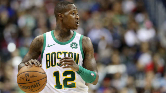 WASHINGTON, DC - APRIL 09: Terry Rozier #12 of the Boston Celtics dribbles the ball against the Washington Wizards in the second half at Capital One Arena on April 09, 2019 in Washington, DC. NOTE TO USER: User expressly acknowledges and agrees that, by downloading and or using this photograph, User is consenting to the terms and conditions of the Getty Images License Agreement. (Photo by Rob Carr/Getty Images)