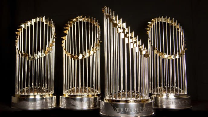 BOSTON, MA - NOVEMBER 26: The Boston Red Sox 2004, 2007, 2013, and 2018 World Series trophies are displayed on November 26, 2018 at Fenway Park in Boston, Massachusetts. (Photo by Billie Weiss/Boston Red Sox/Getty Images)