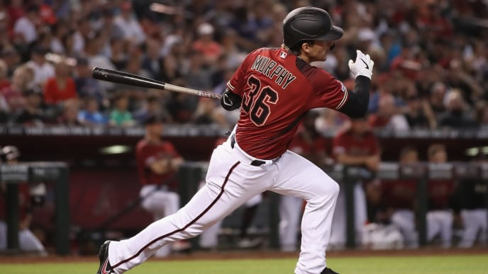 PHOENIX, ARIZONA - APRIL 07:  John Ryan Murphy #36 of the Arizona Diamondbacks hits a single against the Boston Red Sox during the third inning of the MLB game at Chase Field on April 07, 2019 in Phoenix, Arizona. (Photo by Christian Petersen/Getty Images)