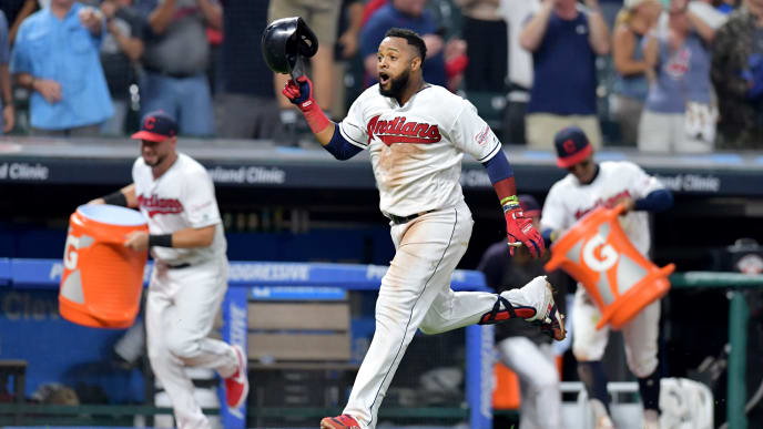 CLEVELAND, OHIO - AUGUST 12: Carlos Santana #41 of the Cleveland Indians rounds the bases on his walk-off solo home run to defeat the Boston Red Sox 6-5 at Progressive Field on August 12, 2019 in Cleveland, Ohio.  (Photo by Jason Miller/Getty Images)