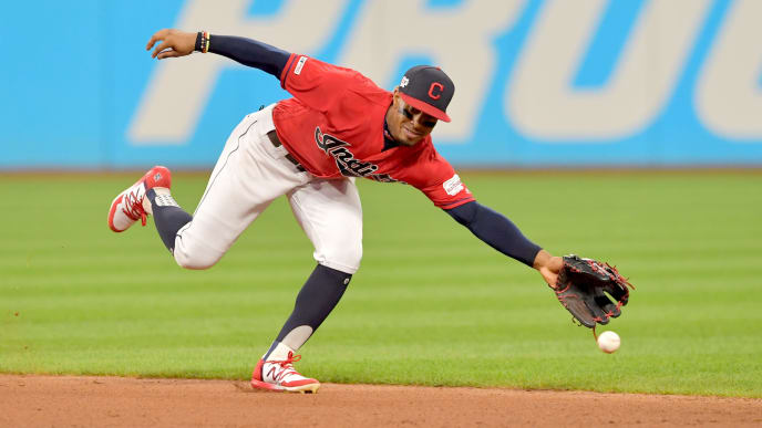 CLEVELAND, OHIO - AUGUST 13: Shortstop Francisco Lindor #12 of the Cleveland Indians can't get to a ground ball hit by Rafael Devers #11 of the Boston Red Sox during the fifth inning at Progressive Field on August 13, 2019 in Cleveland, Ohio. (Photo by Jason Miller/Getty Images)