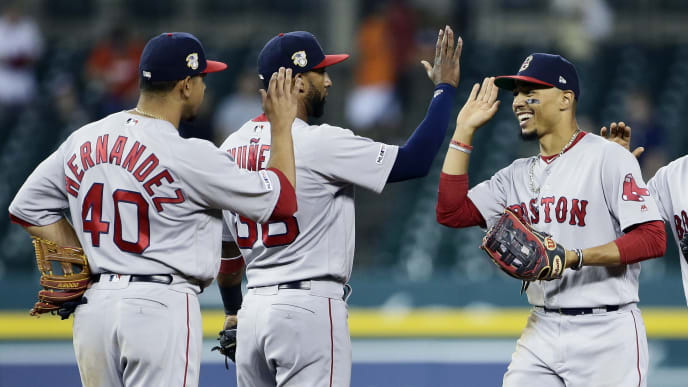 DETROIT, MI - JULY 7:  Mookie Betts #50 of the Boston Red Sox, right, celebrates with Marco Hernandez #40 and Eduardo Nunez #36 after a 10-6 win over the Detroit Tigers at Comerica Park on July 7, 2019 in Detroit, Michigan. (Photo by Duane Burleson/Getty Images)