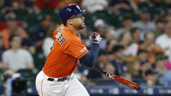 HOUSTON, TEXAS - MAY 24: George Springer #4 of the Houston Astros flies out to center field in the first inning against the Boston Red Sox at Minute Maid Park on May 24, 2019 in Houston, Texas. (Photo by Bob Levey/Getty Images)