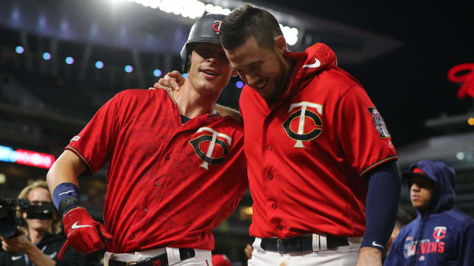 MINNEAPOLIS, MINNESOTA - JUNE 19: (L-R)  Max Kepler #26 and C.J. Cron #24 of the Minnesota Twins celebrate with after defeating the Boston Red Sox 4-3 in seventeen innings at Target Field on June 19, 2018 in Minneapolis, Minnesota. (Photo by Adam Bettcher/Getty Images)