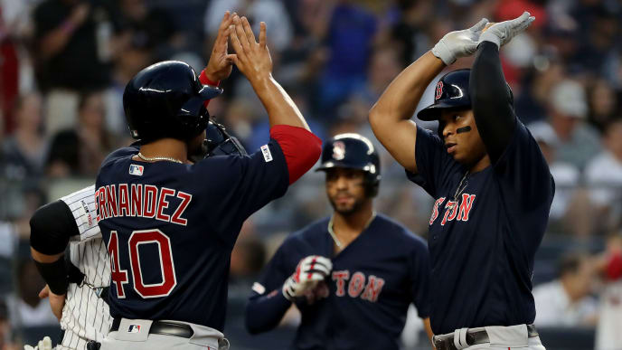 NEW YORK, NEW YORK - AUGUST 03:  Marco Hernandez #40 and Rafael Devers #11 of the Boston Red Sox celebrate after Devers drove them both home with a two run home run in the third inning against the New York Yankees during game two of a double header at Yankee Stadium on August 03, 2019 in New York City. (Photo by Elsa/Getty Images)