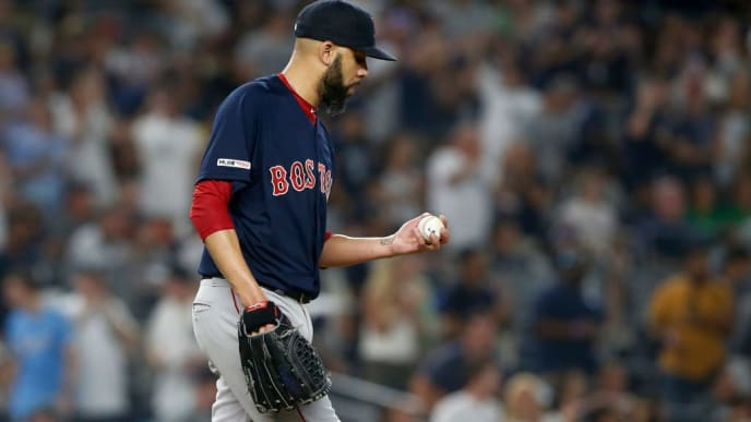 NEW YORK, NEW YORK - AUGUST 04:  David Price #10 of the Boston Red Sox looks at the ball from the mound during the third inning against the New York Yankees at Yankee Stadium on August 04, 2019 in New York City. (Photo by Jim McIsaac/Getty Images)