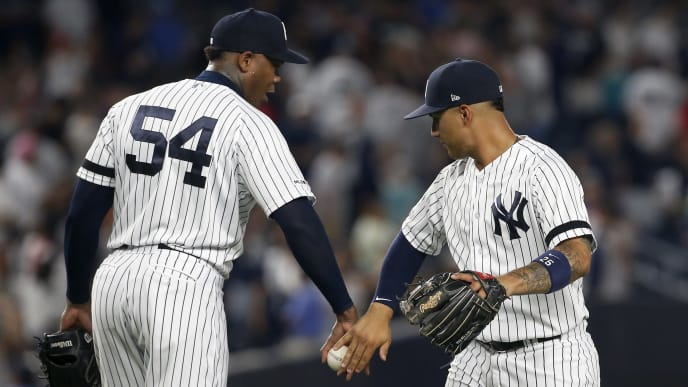 NEW YORK, NEW YORK - AUGUST 02:   Aroldis Chapman #54 and Gleyber Torres #25 of the New York Yankees celebrate after defeating the Boston Red Sox at Yankee Stadium on August 02, 2019 in New York City. (Photo by Jim McIsaac/Getty Images)