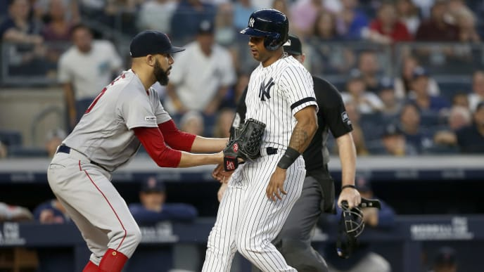 NEW YORK, NEW YORK - JUNE 02:  David Price #10 of the Boston Red Sox tags out Aaron Hicks #31 of the New York Yankees as he tries to score ending the fourth inning at Yankee Stadium on June 02, 2019 in New York City. (Photo by Jim McIsaac/Getty Images)