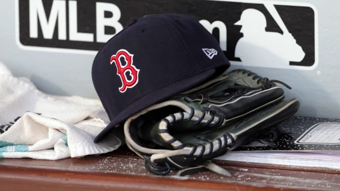 PHILADELPHIA, PA - AUGUST 14: A Red Sox hat sits on the bench in the dugout before a game between the Boston Red Sox and the Philadelphia Phillies at Citizens Bank Park on August 14, 2018 in Philadelphia, Pennsylvania. The Red Sox won 2-1. (Photo by Hunter Martin/Getty Images)